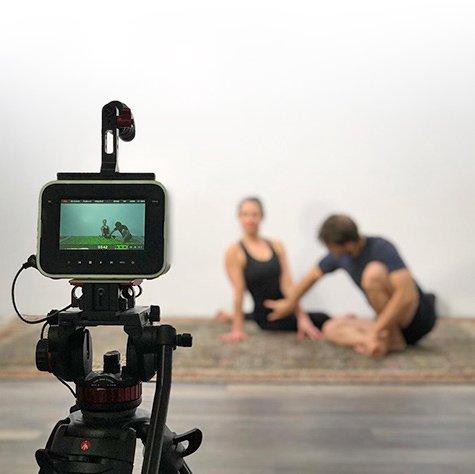 Yoga instructors behind camera